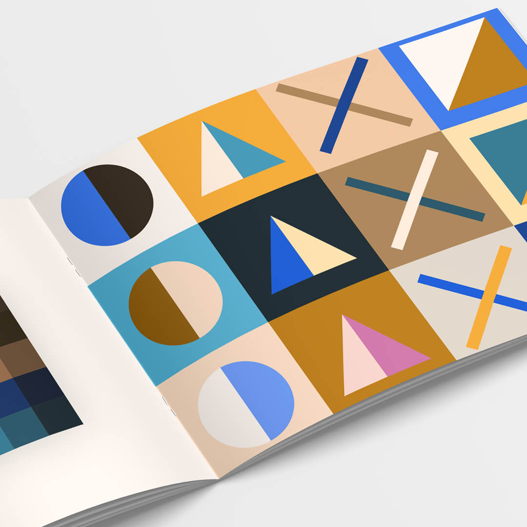 Mockup of a booklet with different colored circles, triangles, squares and Xs.