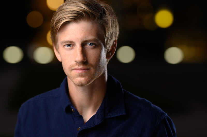 Modern headshot of a young man with blonde hair