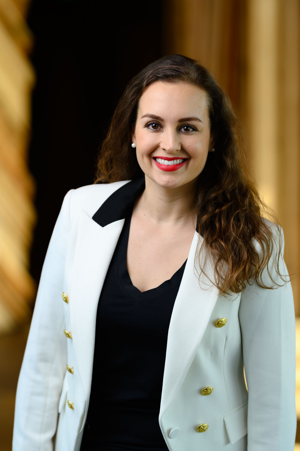 Business portrait of a young woman in a white suit jacket