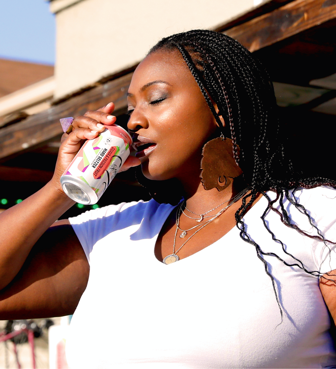 A woman enjoying a can of SOMA Hard Seltzer by 21st Amendment Brewery