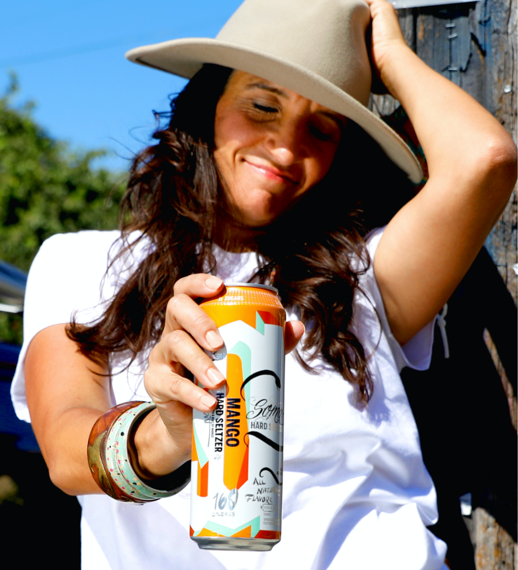 A woman holding a can of SOMA Hard Seltzer by 21st Amendment Brewery