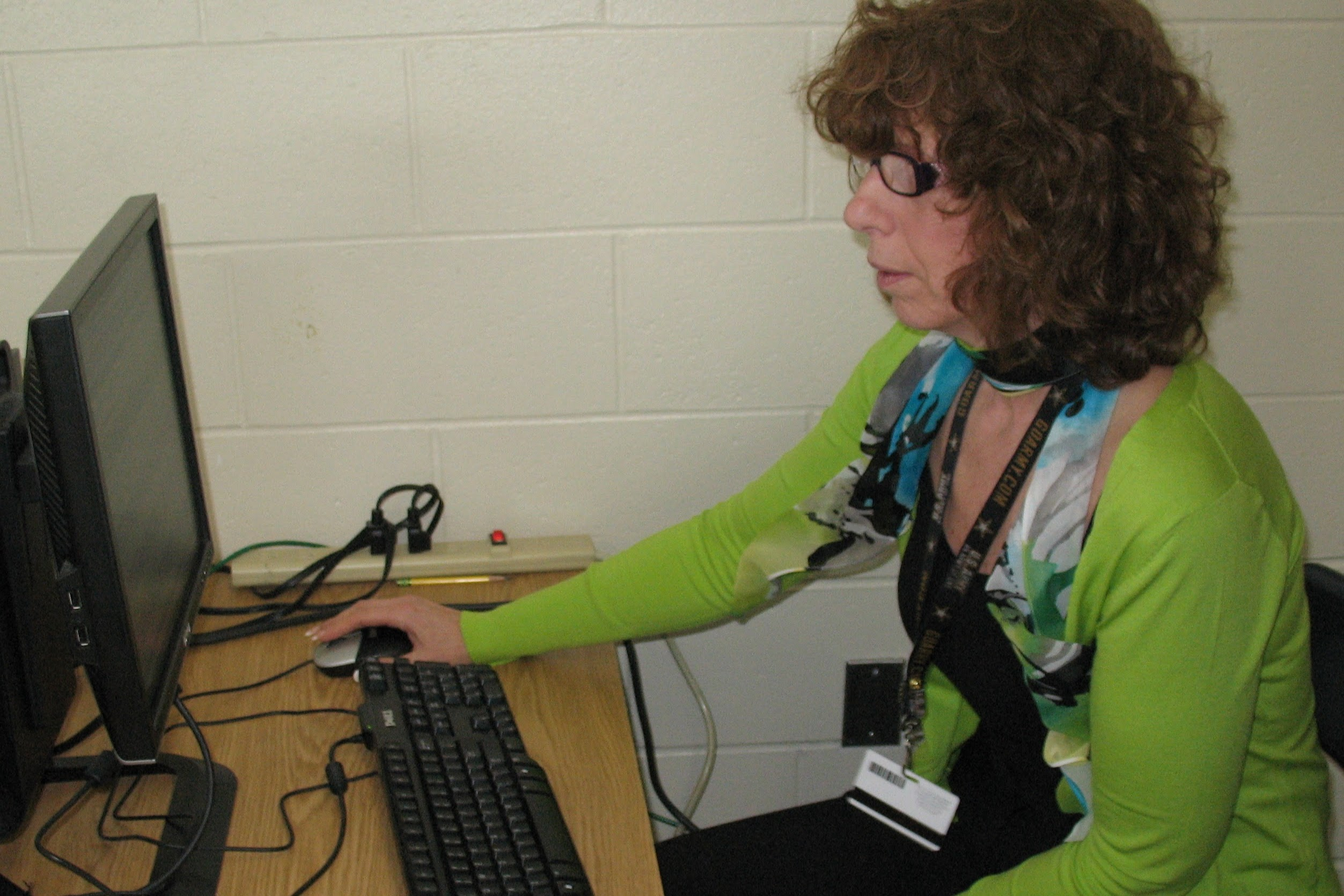 ASSISTments teacher at computer