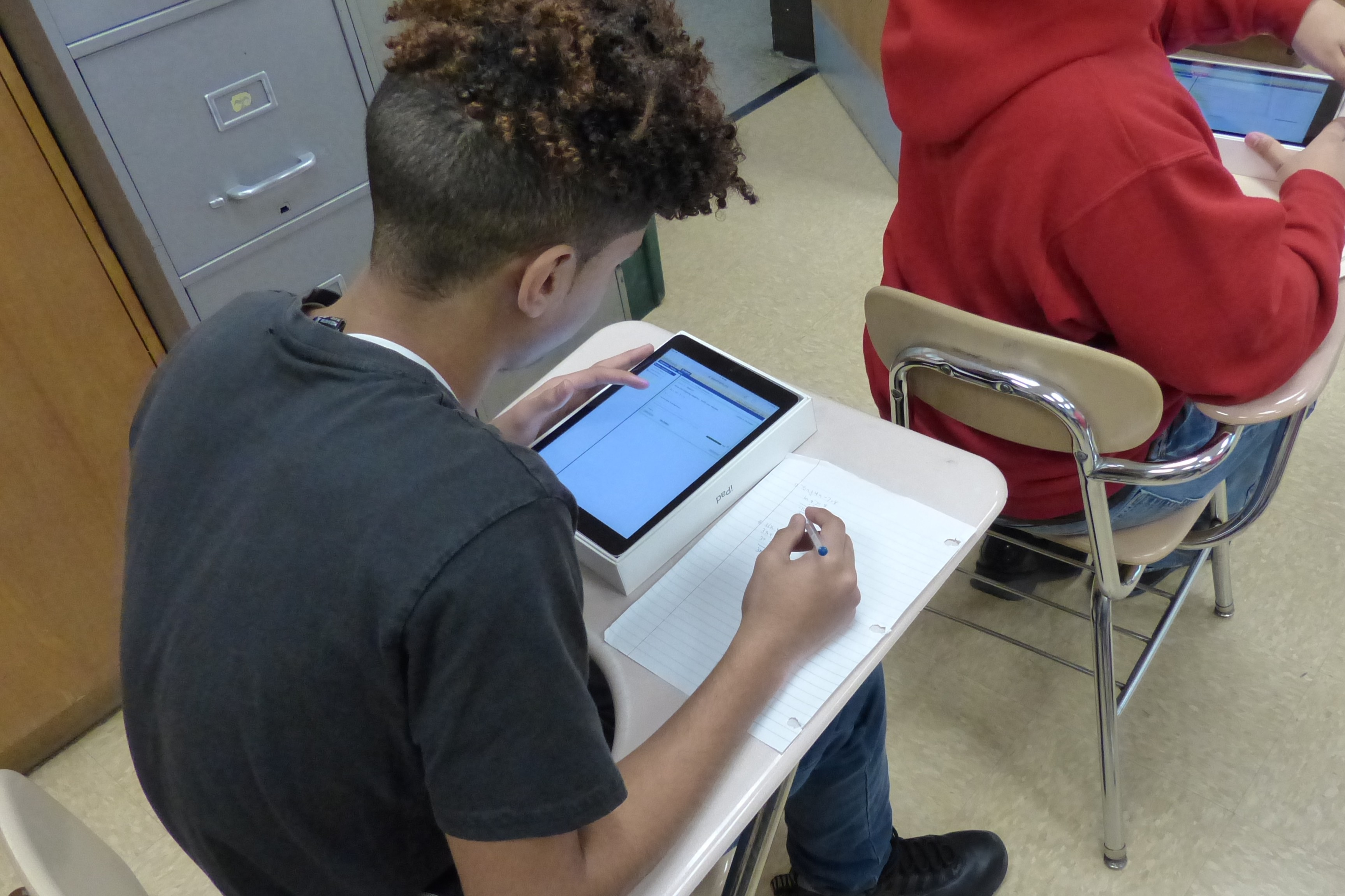 ASSISTments student with tablet
