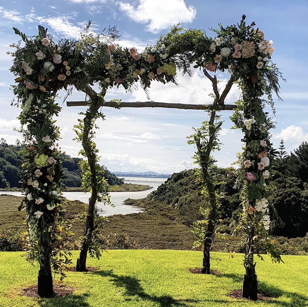 Auckland wedding florist - floral arch installation