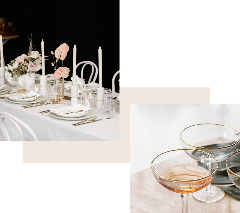 Wedding table styling including candles and unique glassware.