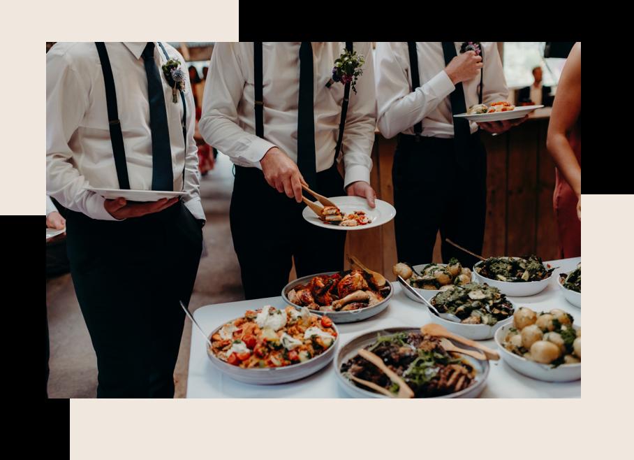 Groom serving meal at wedding