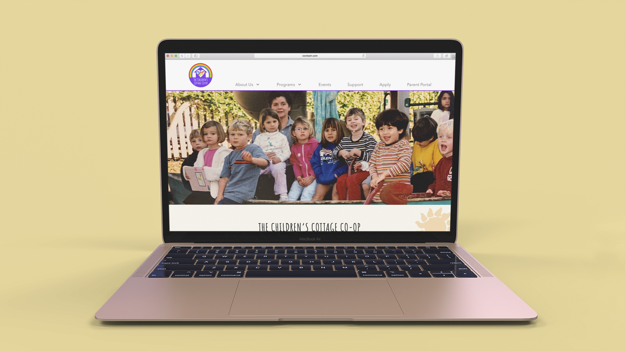 A mockup showing the new Children's Cottage website on a Macbook Pro.