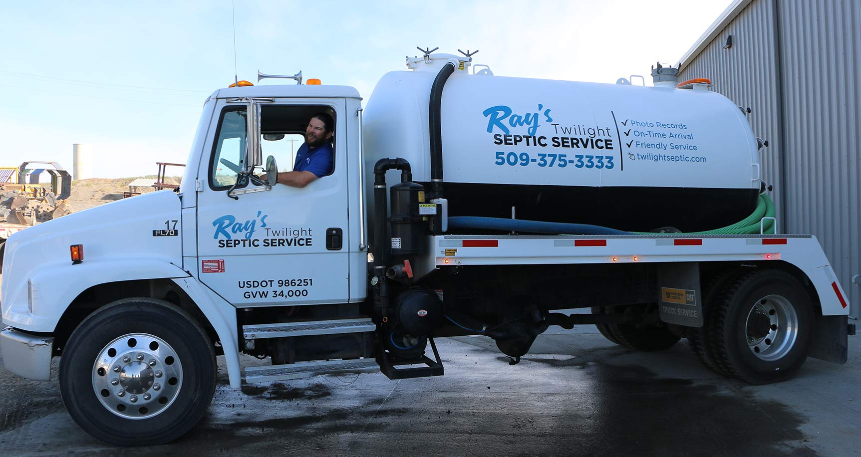 Tri-Cities Septic Service company truck and driver