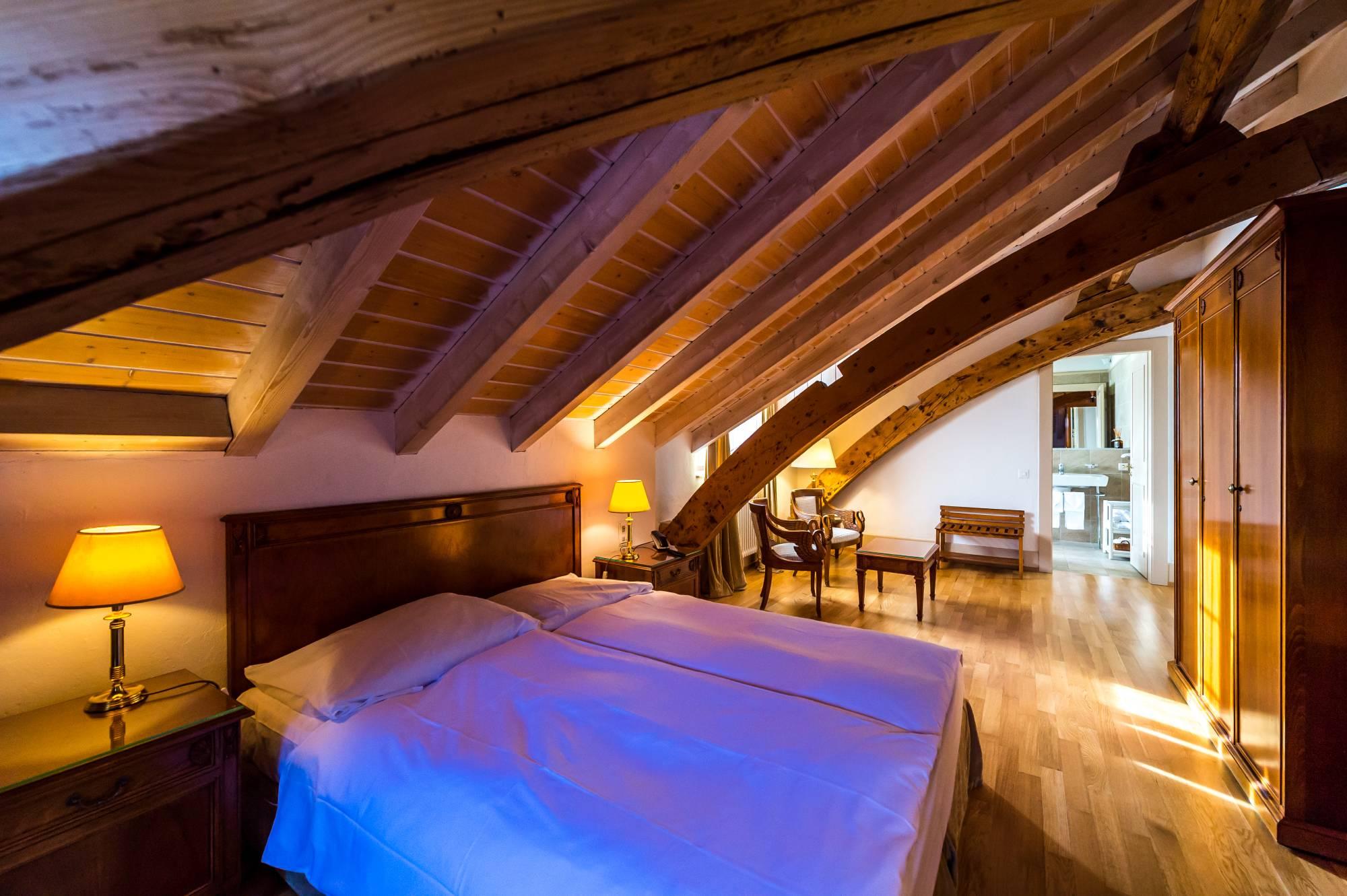 Galerie photo des chambres de la partie hôtel de l'Auberge du Raisin à Cully