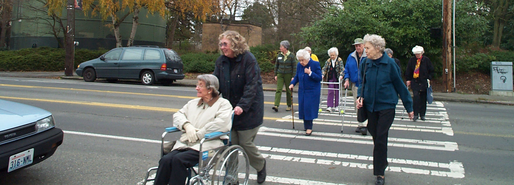 group of seniors crossing the street