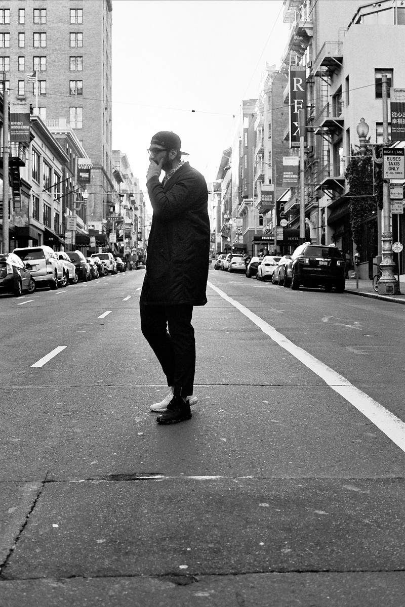 Black and white photo of Oscar in the middle of the street