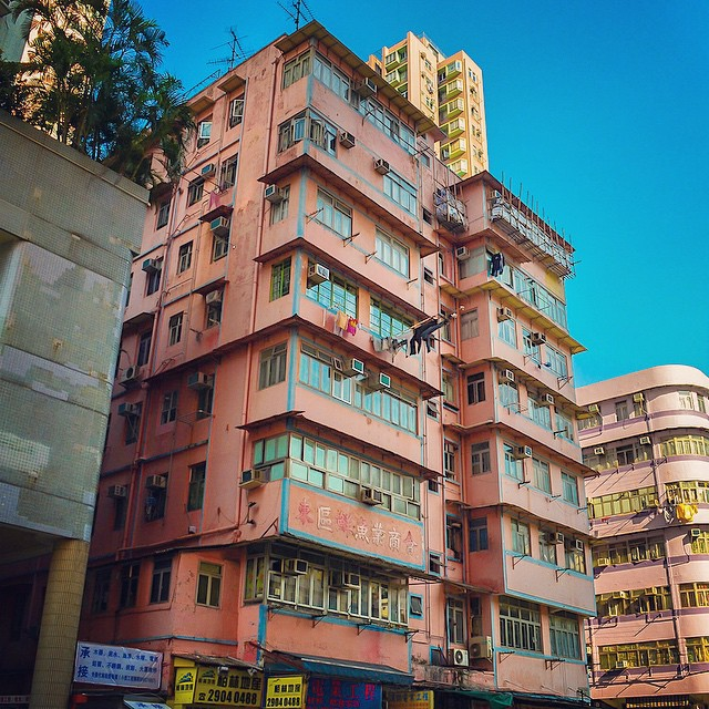 Pink housing block against a blue sky in Hong Kong