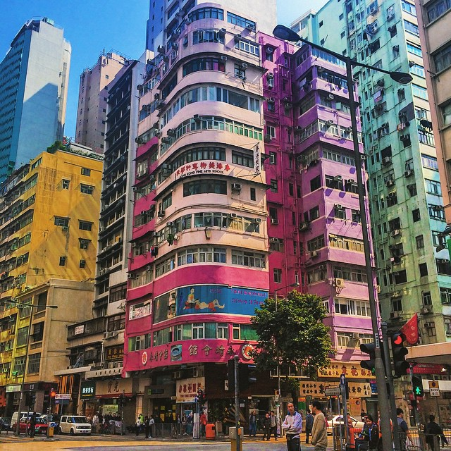 Pink building turning the street corner in Hong Kong