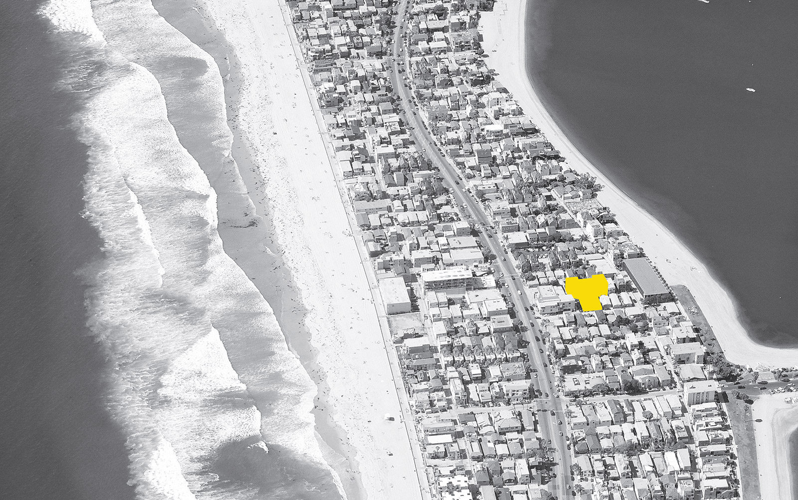 Aerial photo showing the infill site used for QTCT in relation to the beach and the bay along Mission Beach, San Diego