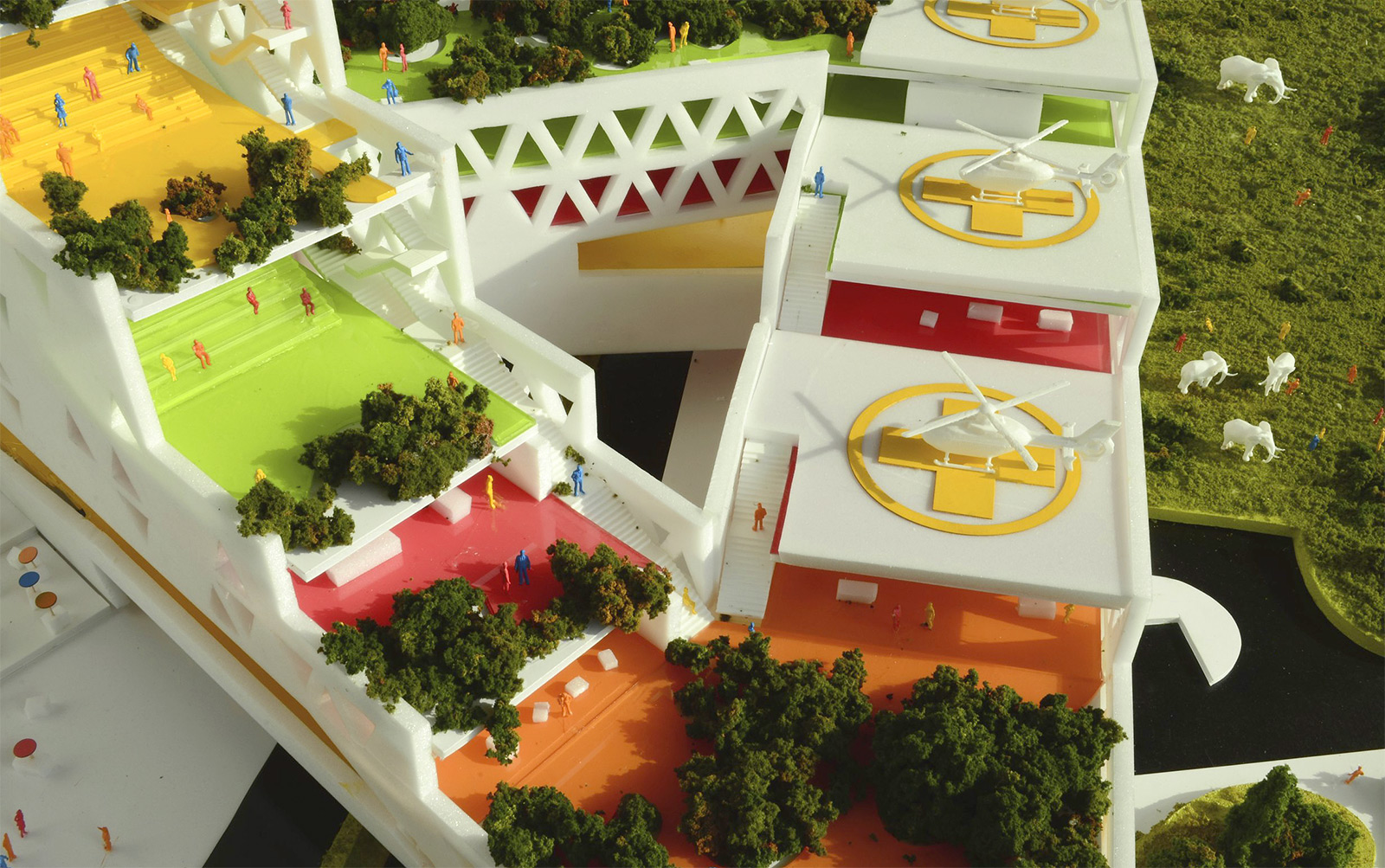 Aerial of the corner of the GBN model showing the layers of gardens and public spaces and the stacked ecotourism helipads
