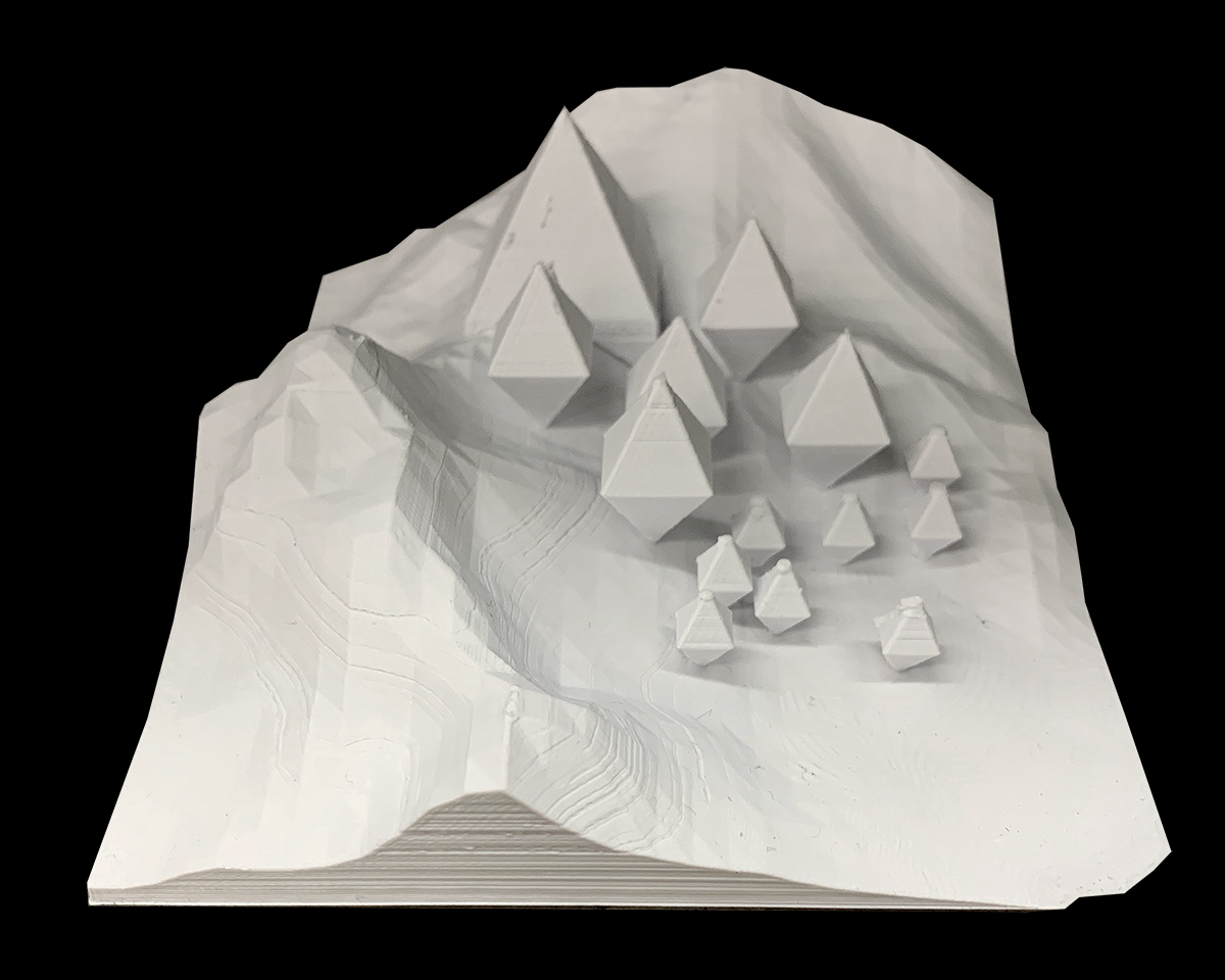 Front perspective of a model showing various pyramidal forms stepping up the side of a mountain by student Lamarra Carter