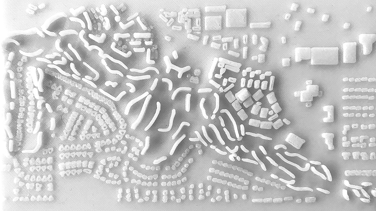 Plan view of a physical model showing the housing bars shaped between open spaces of golf courses by student Adrisda Maulsi