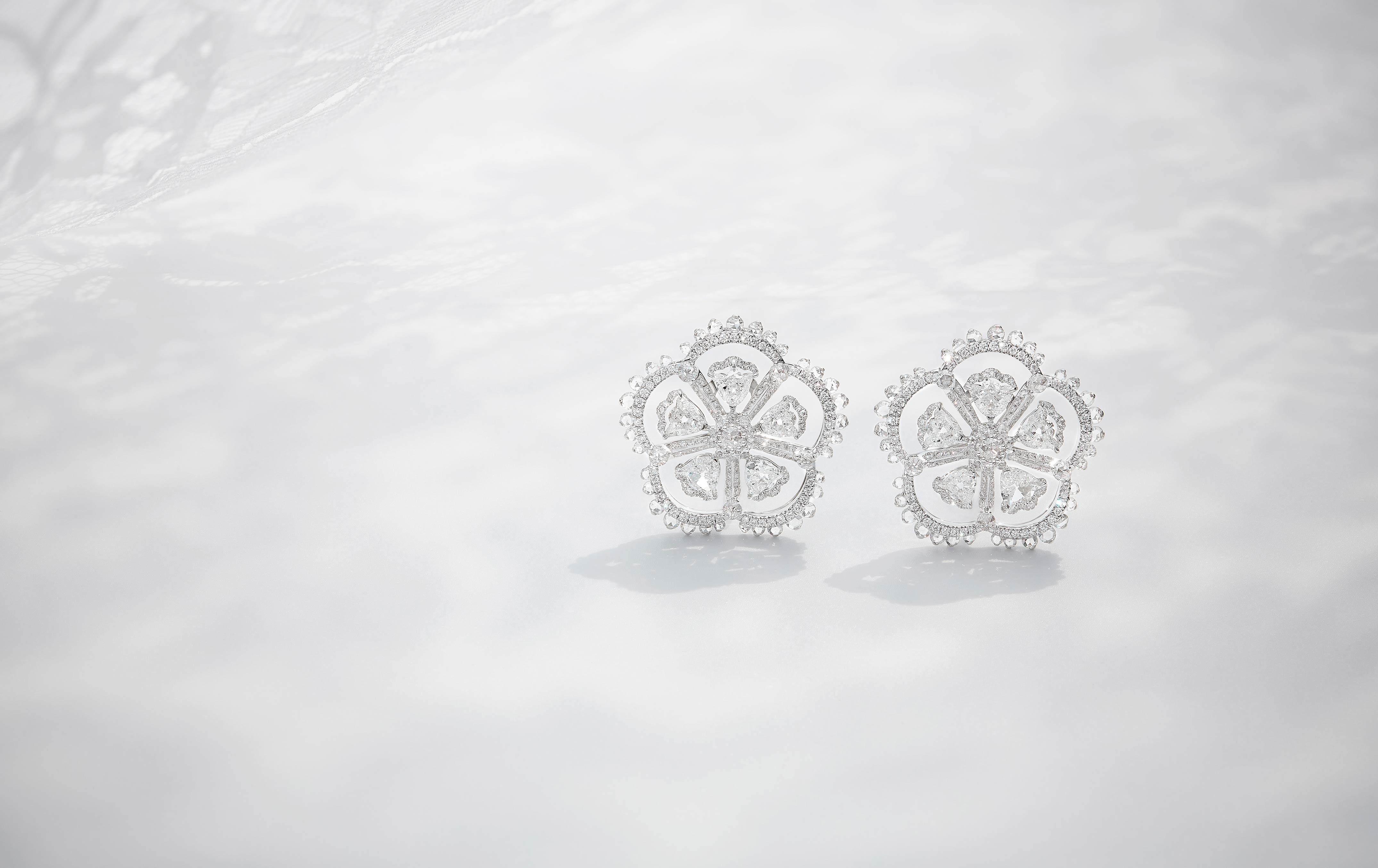 White gold enhances the wistful sheerness of the filigree.