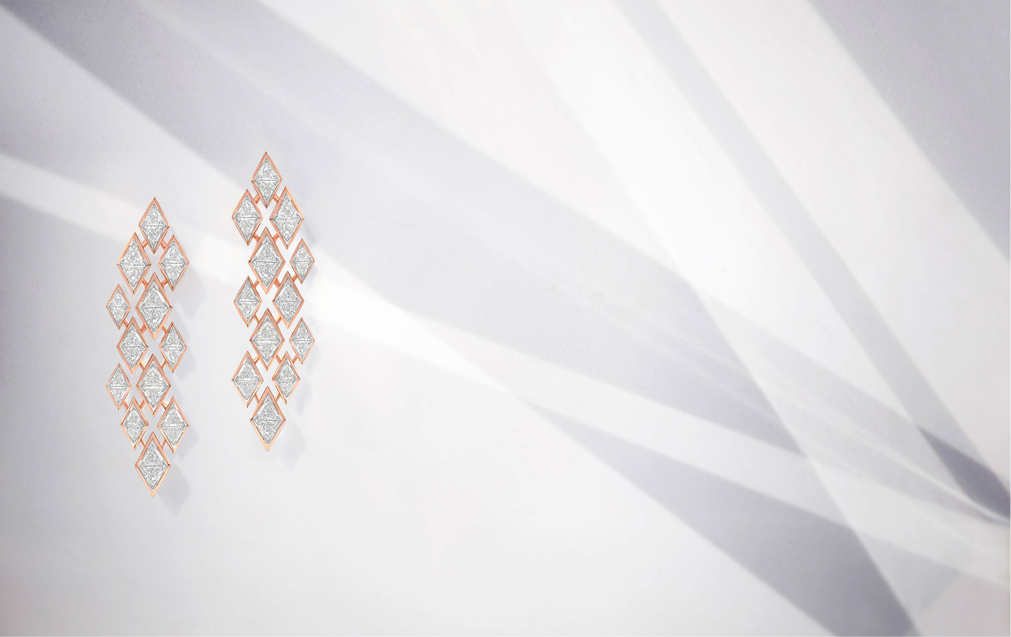 Earrings - trillion-cut, faceted diamonds set like pyramids in a geometric pattern.