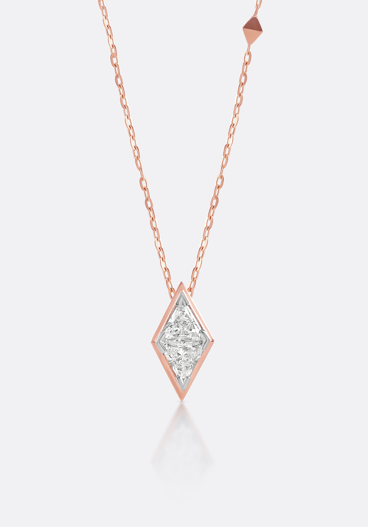 Pendant - sharp silhouettes and faceted diamonds create an eye-catching effect.
