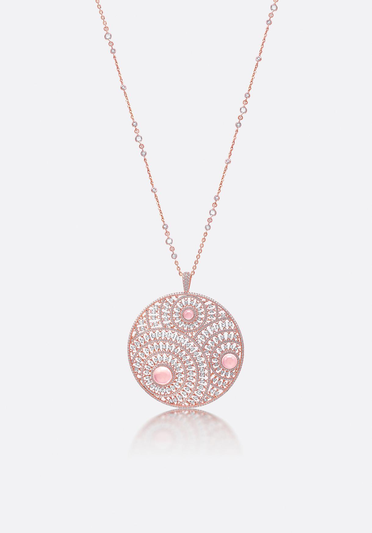 Diamonds are patterned around elegant, centred rose quartzes.