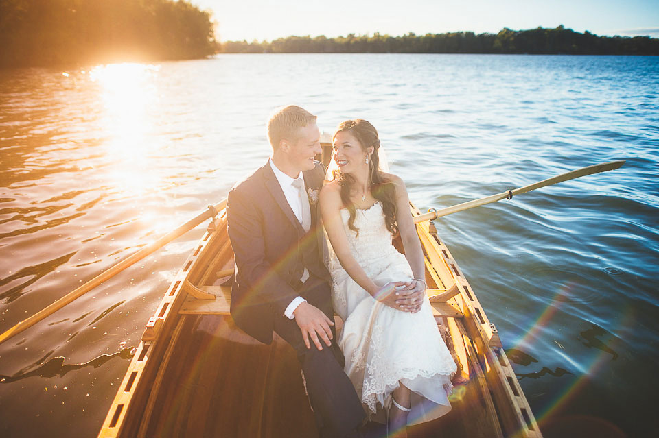 Bride and groom in a rowing boat near the island