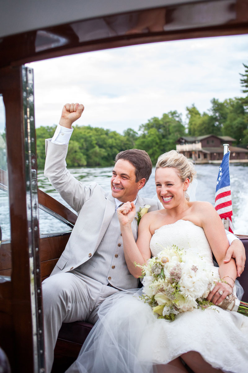 Bride and groom riding in a motorboat