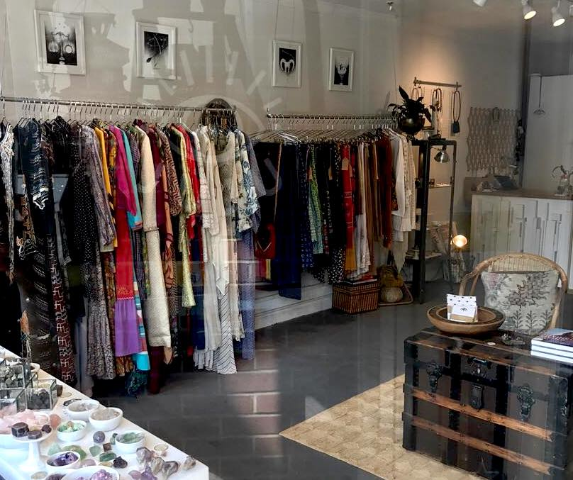 Juju clothing selection. Multiple clothing racks are featured.