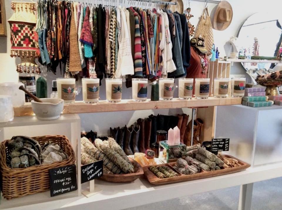 selection of clothing, candles and bath  products at Juju