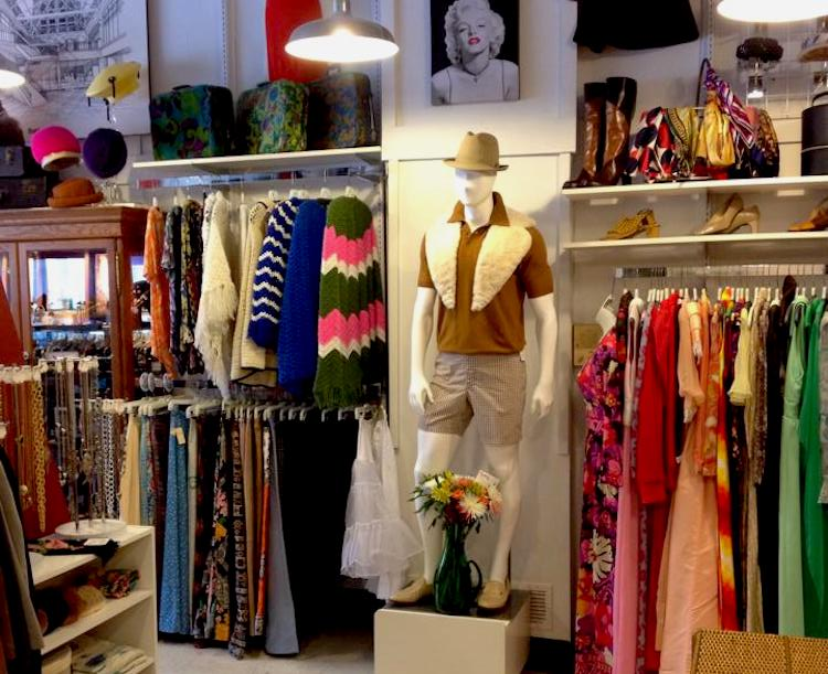 At Three Rivers Vintage, a manican, plenty of clothes, and painting of Marilyn Monroe are featured