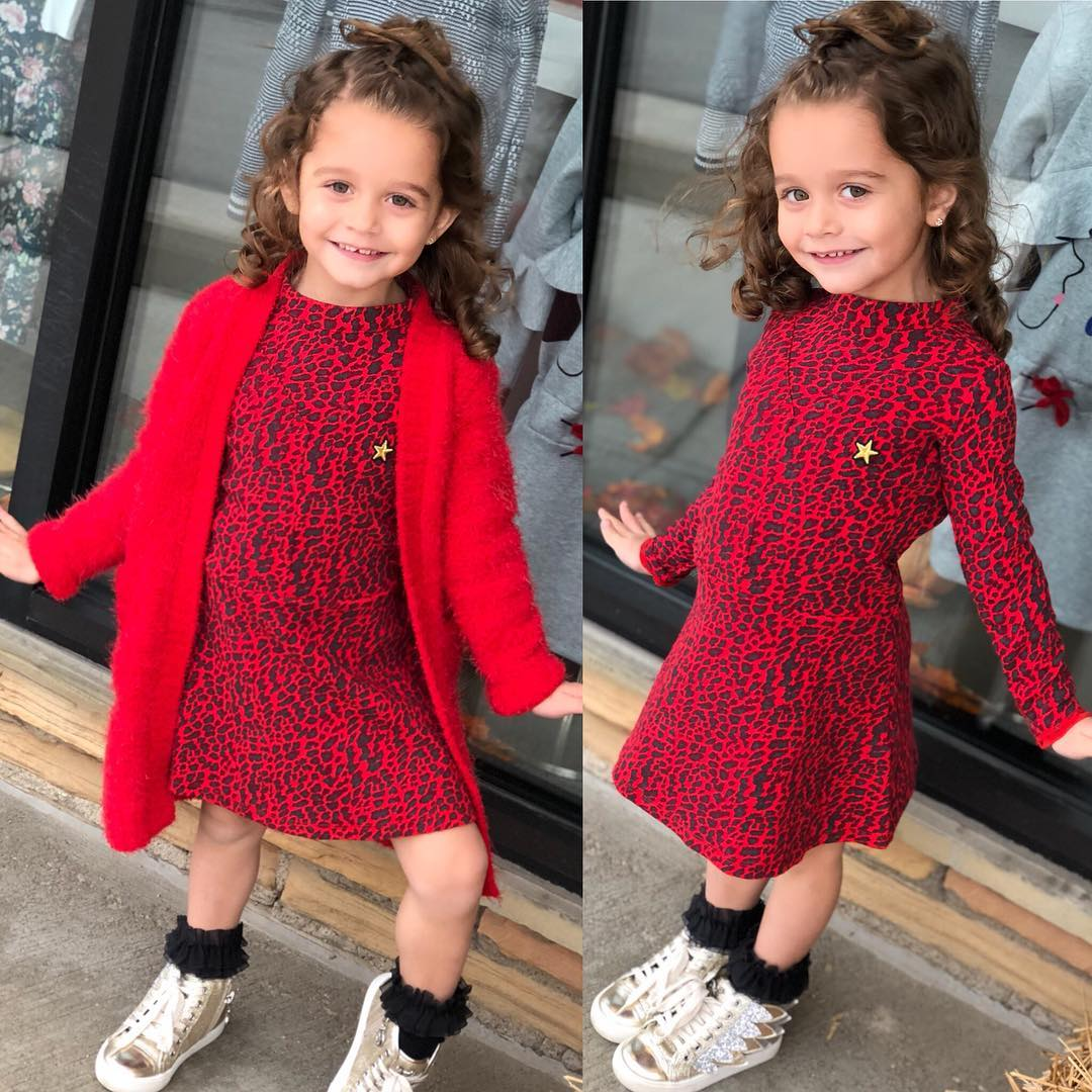 little girl posing in cute outfit from Lullaby Landing