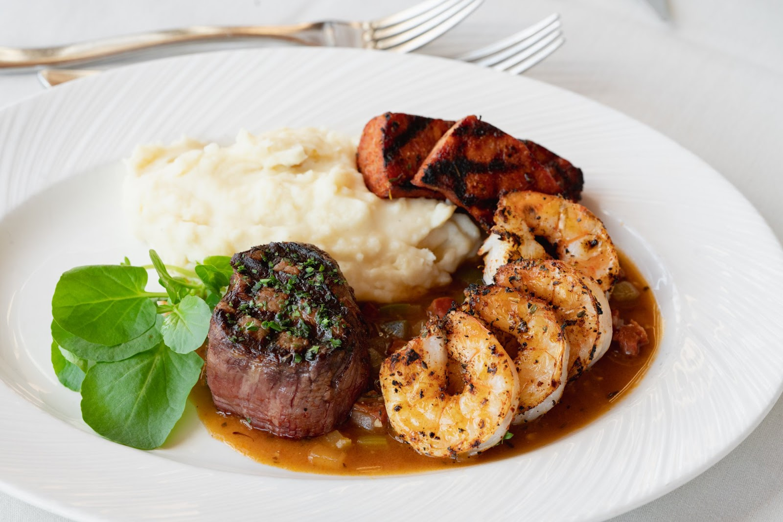 One of Eddie Merlot's featured dishes with steak, shrimp and mashed potatoes