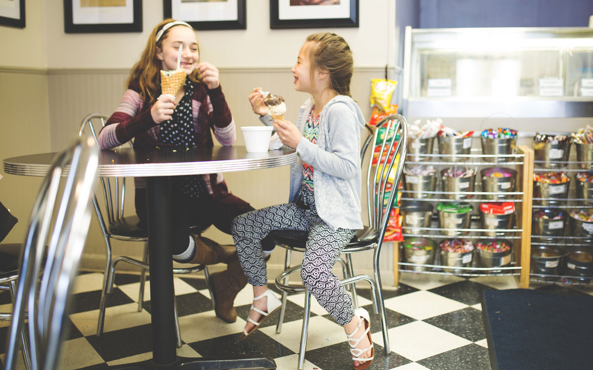 Kids eat ice cream at Scoops on Beverly