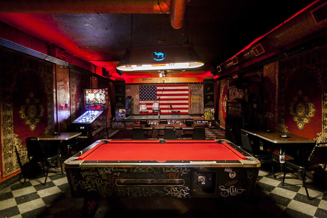 stage and pool table inside Gooski's dive bar