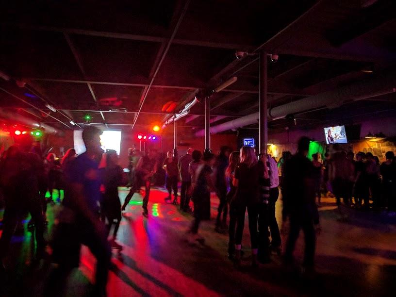 people roller skating inside Belvederes Ultra Dive bar & dance club
