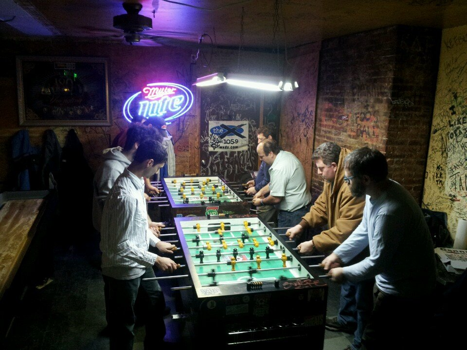 men playing foosball in Brewski's Bar in Pittsburgh