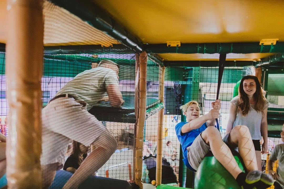 A family is playing in the ballocity play area at Fun Fore All