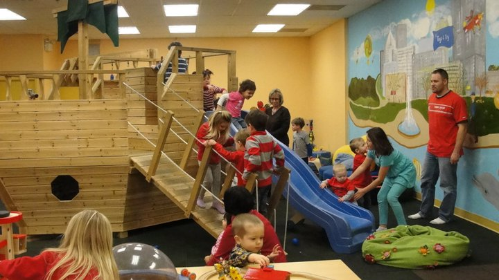 A group of kids play on an indoor pirate ship at E2 Toys to Try