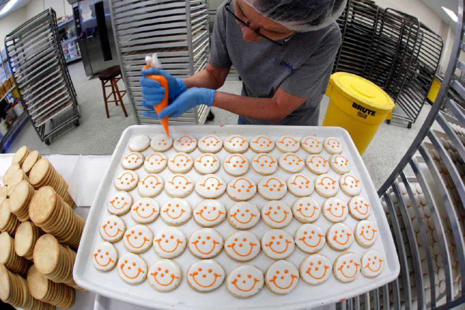 Eat n Park icing the famous Smiley cookies