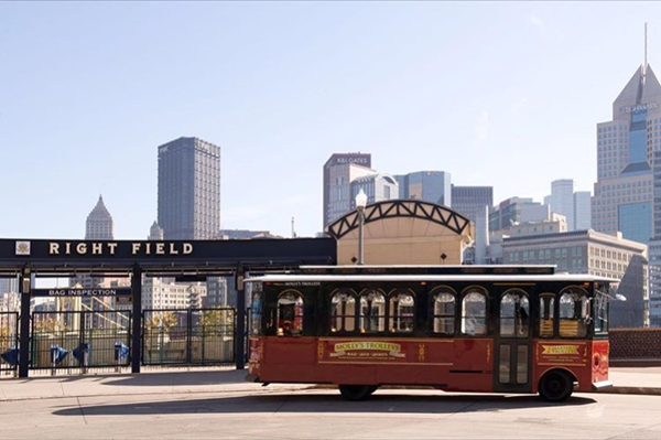 Trolley parked in front of Pittsburgh skyline