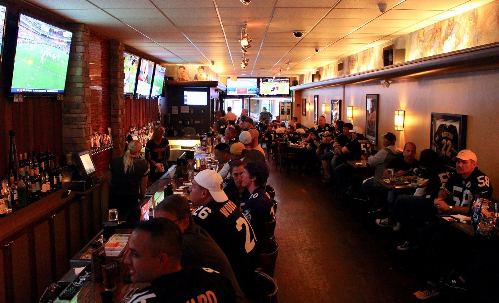 Pittsburgh sports fans gather around the bar Rebeard's on Sixth