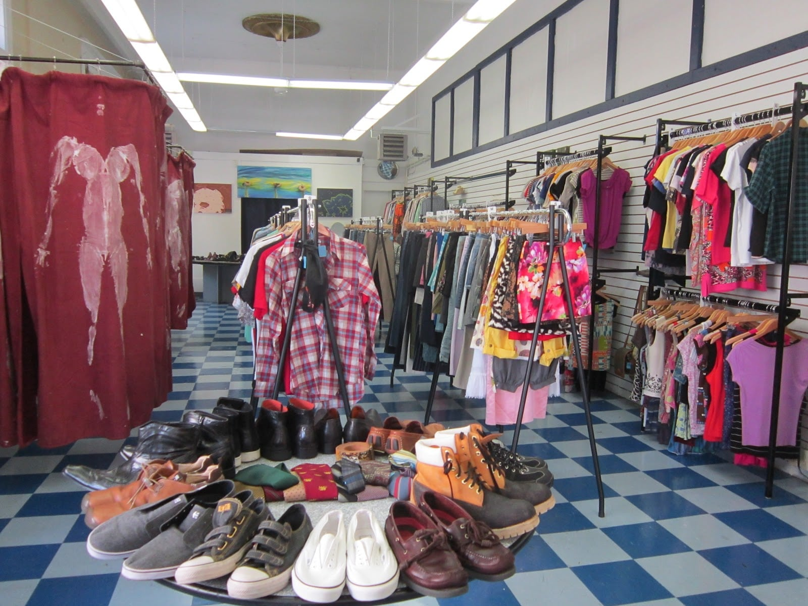 Clothes Minded boutique with shoes and clothes that line the racks