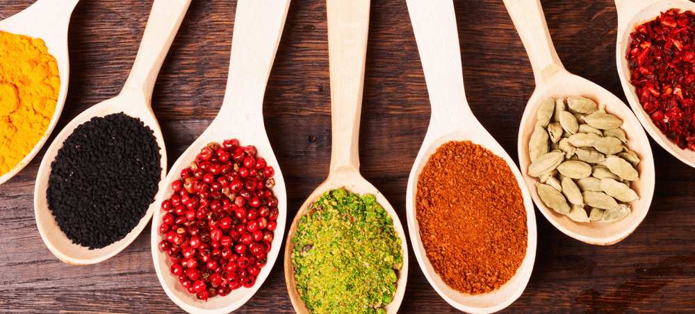 a collection of spices on spoons