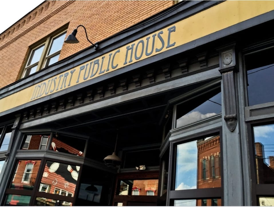 Outside sign of Industry Public House