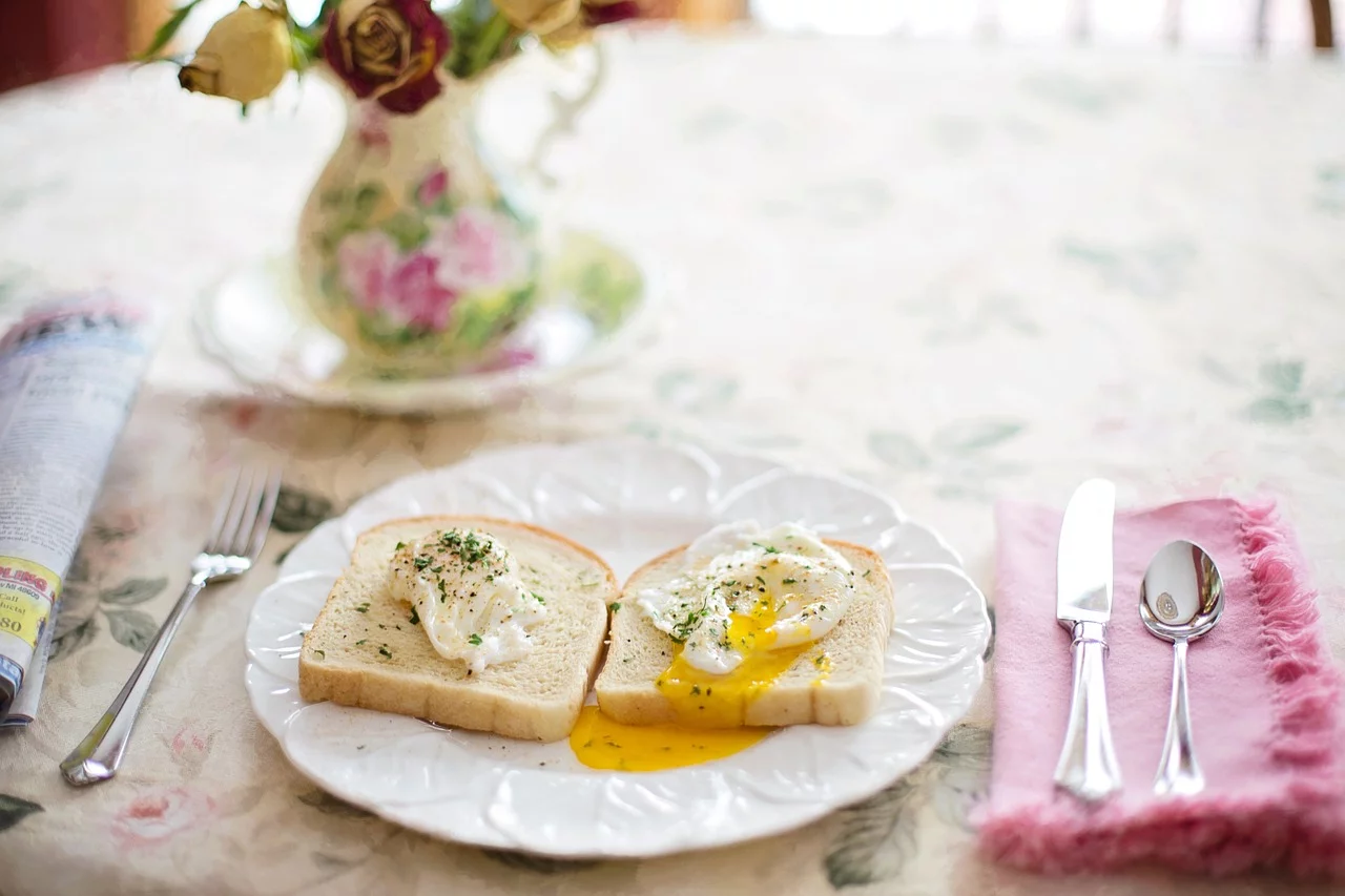 Yummy! Toast with two poached eggs and some fresh herbs.