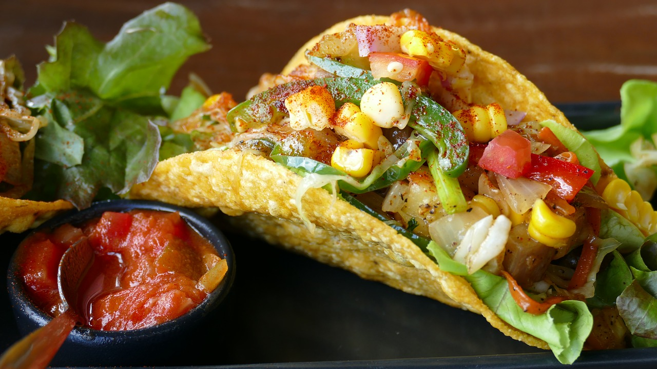 Authentic tacos with corn salsa and lettuce