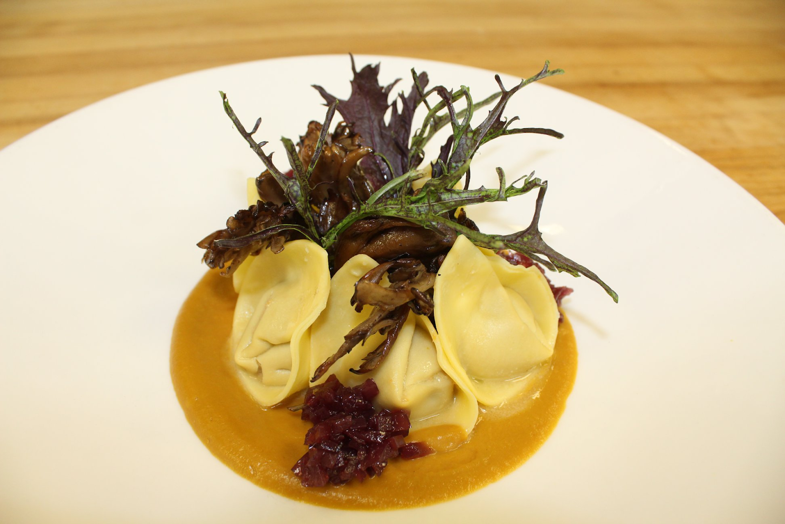 A creatively plated dish of won tons