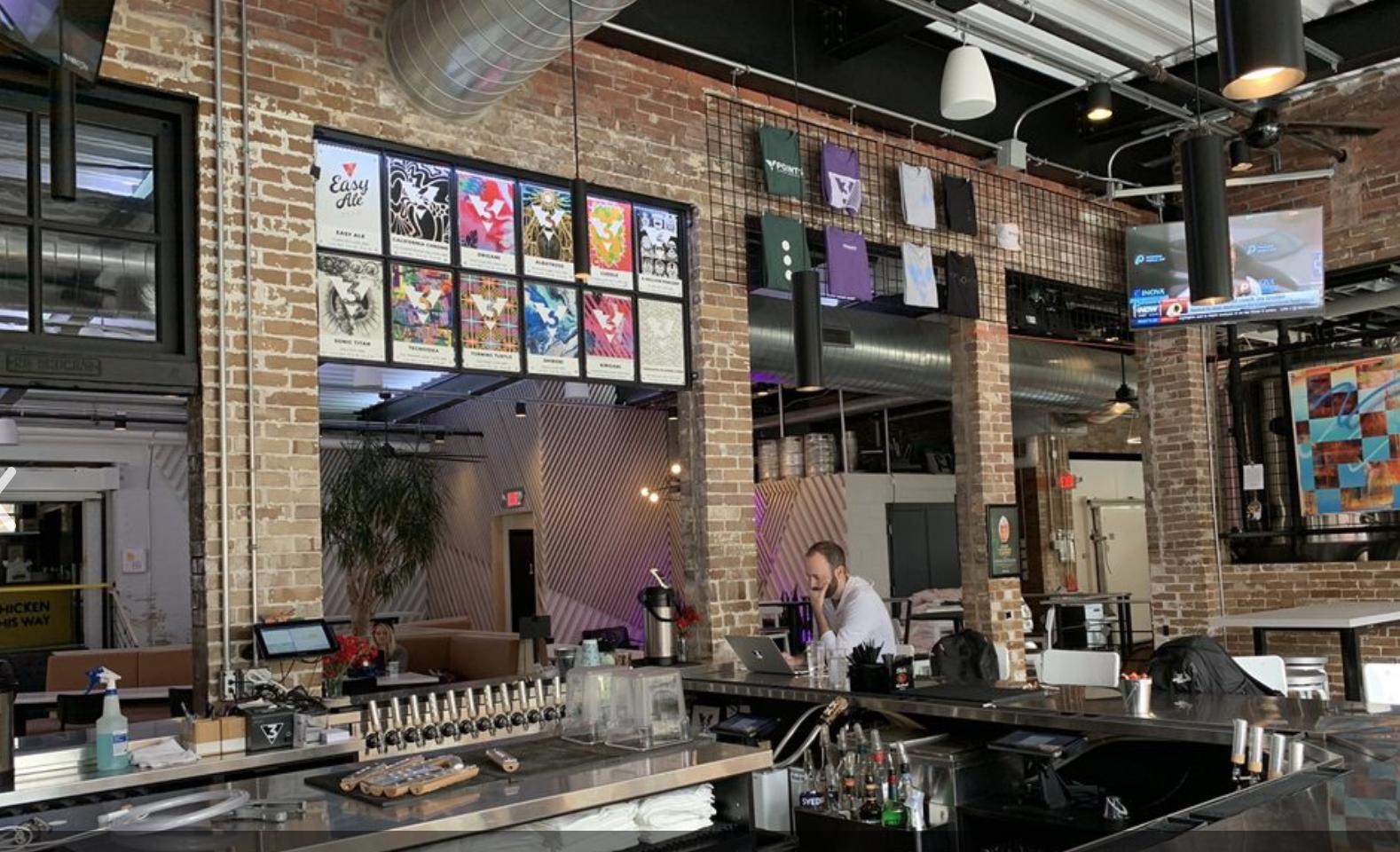 A bar with high ceilings, like a loft