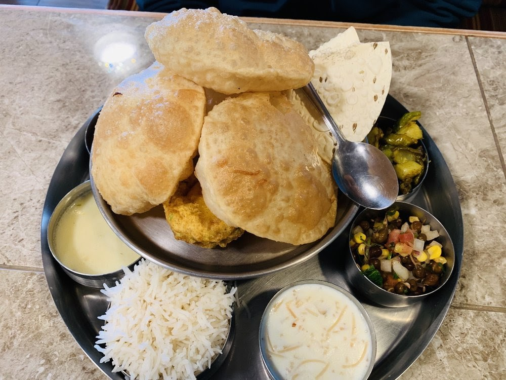 Photo of Swad Indian Vegetarian Restaurant - Round Rock, TX, United States. Thali Special with poori