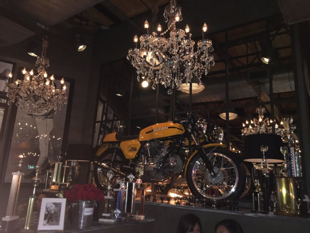 Photo of Town Hearth - Dallas, TX, United States. Motorcycle against the wall in the restaurant